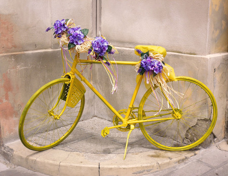 Yellow Bike Shop Decoration Covered in Flowers