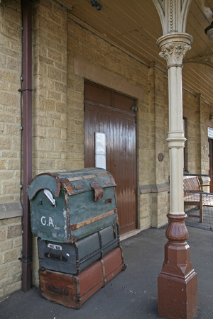 Victorian Railway Station with Vintage Luggage Stack Stock Photo