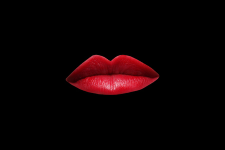 Female lips with red lipstick close up on black background