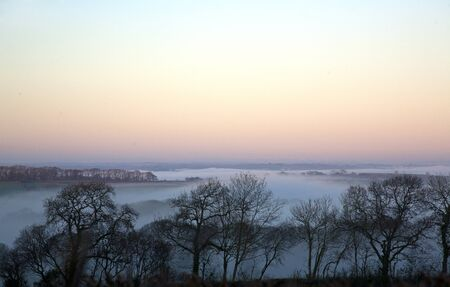 Magical Mist over the rural countryside on a winter evening