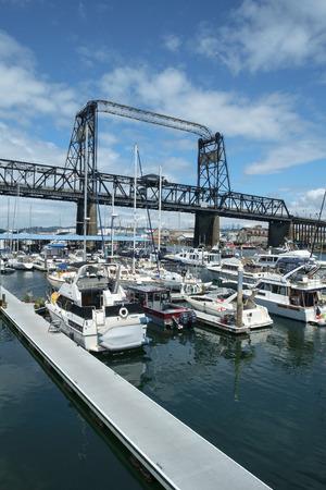 Tacoma, WA, USA July 03, 2016: Recently renovated Murray Morgan Bridge and marina along the Thea Foss waterway Editorial
