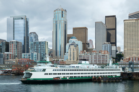 elliot: Seattle, USA August 7, 2016: Washington State Ferry Wenatchee at Coleman Dock at Pier 52 in Seattle with Seattle skyline in background