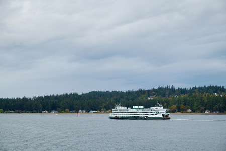 Seattle, WA October 1, 2016: Washington State Ferry MV Hyak pass southern end of Bainbridge Island heading for Bremerton , WA Editorial