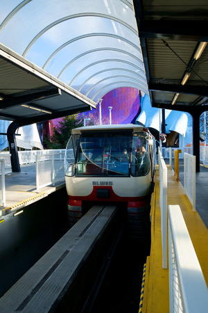 Seattle, WA, USA December 06, 2016: Seattles iconoc monorail enters station at Seattle Center, home of the Space Needle, Experience Music Project, and Pacific Science Center