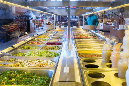 upscale: Bainbridge, WA, USA Feb. 11, 2017: Self-serve salad bar in upscale grocery store with a variety of freash vegetables Editorial