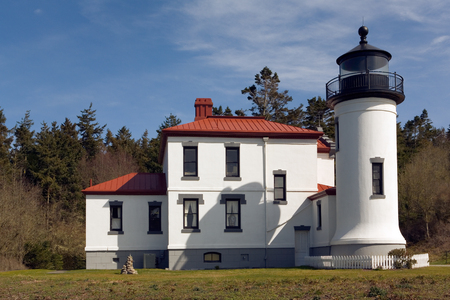 Coupeville, WA, USA March 27, 2006: Admiralty Head Lighthouse, located at Fort Casey on Whidbey Island in Washington state, was built in 1861 and ceased operation as a lighthouse in 1922. Today it is a popular tourist attraction.