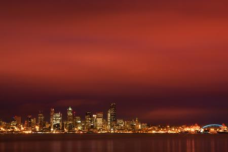 elliot: Seattle, WA, USA Dec. 8, 2011: City skyline of Seattle, Washington still has its lights on as a fiery dawn breaks over Puget Sound and Elliott Bay