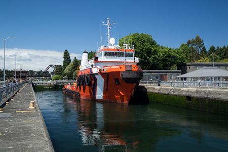 Seattle, WA, USA June 12, 2015: Resolve Pioneer large assist vessel being lifted at Ballard Locks