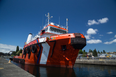 Seattle, WA, USA June 12, 2015: Resolve Pioneer departing large lock at Seattles Ballard Locks after being lifted from the salt waters of Puget Sound to the fresh waters of Salmon Bay