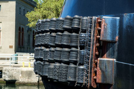 Front  bumper of Titan Class tugboat, Used heavy duty tires make up front bumper on tug boat