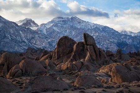 Rock formations in Alabama Hills near Lone Pine, California with Sierra Nevada Mtns. in background Stock Photo