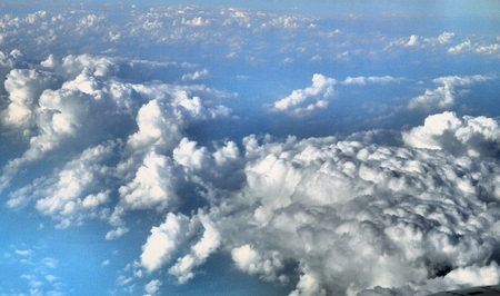 Cloudy blue and white sky captured from a plane