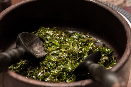 Cooked greens in a wood bowl Stock Photo