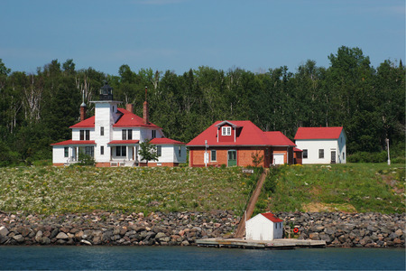 boat dock: Lighthouse with boat dock