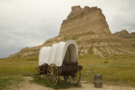 Covered Wagon And Rock Formation Scenic Stock Photo