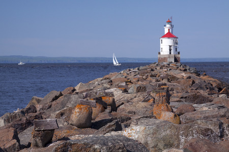 Wisconsin Point Lighthouse with Sailboat photo