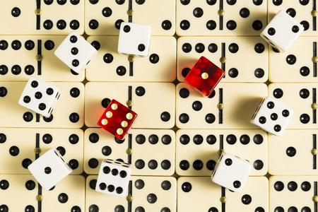 dominoes: Dice On Dominoes Stock Photo