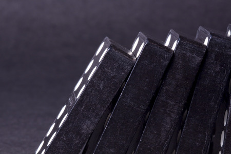 topple: Leaning Black Dominoes