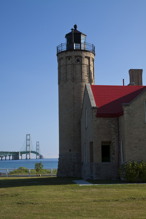 juxtaposition: Old lighthouse with bridge in the background.