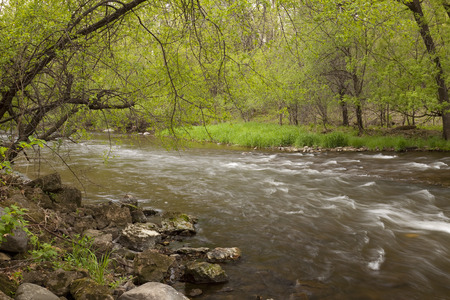 flowing river: Flowing River In Spring Stock Photo