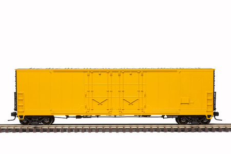 goods train: Yellow Box Car On Railroad Track