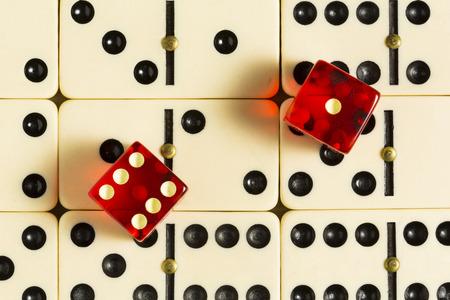 dominoes: Red Dice On Dominoes