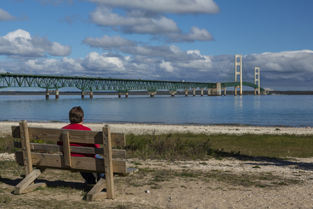 mackinac: Big Mackinac Bridge with person on bench.