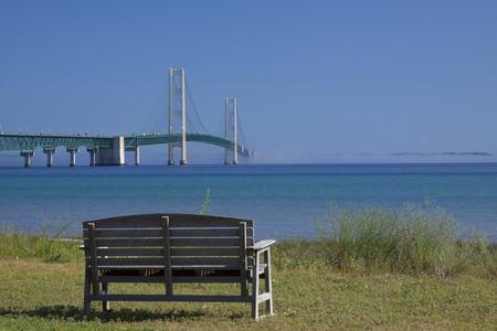 mackinac: Big Mackinac Bridge with park bench. Stock Photo