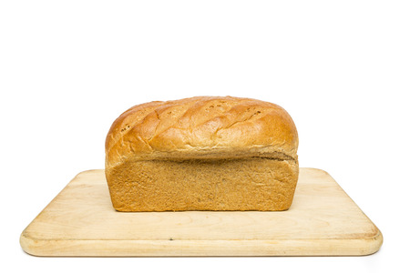 Honey Wheat Bread Loaf On Cutting Board Stock Photo