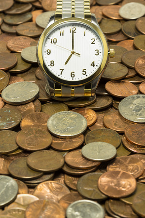 Time Is Money - A watch of a bed of coins.