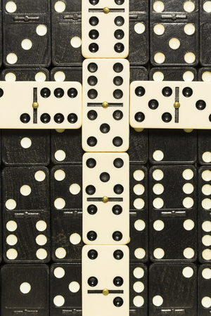 White Dominoes Cross On Black Dominoes Stock Photo