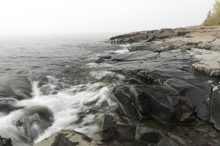 stoney point: Foggy Lake Superior Landscape