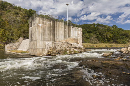 Willow River Dam - A river flowing around a demolished dam.