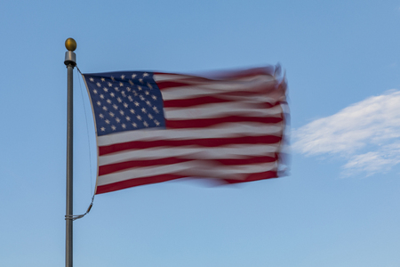 United States Flag in windblown motion. Stock Photo