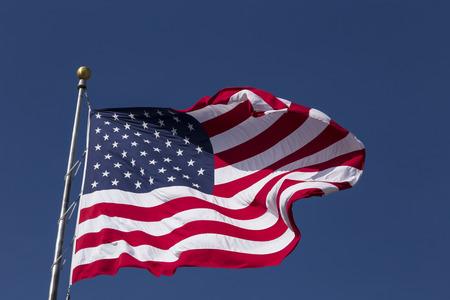 United States Flag against blue sky