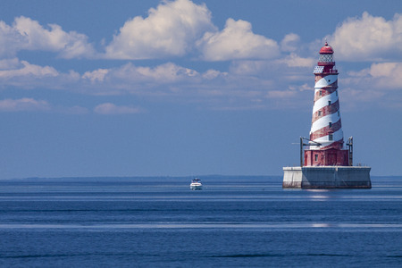 White Shoal Lighthouse with a boat.