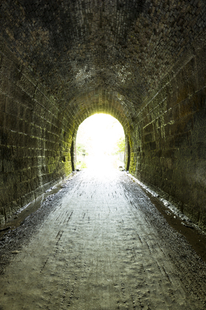 Inside Former Railroad Tunnel Looking Out Stock Photo