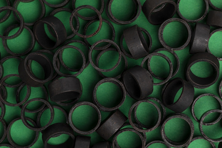 Pex pipe crimp rings with green background. 스톡 콘텐츠