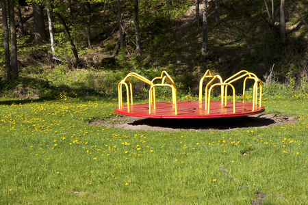 Empty Red and Yellow Merry Go Round In A Park