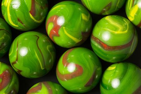 Green, Orange, and Yellow Swirl Marbles