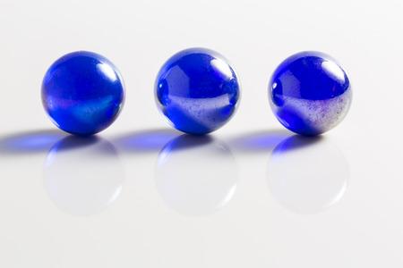 Three Metallic Blue Marbles