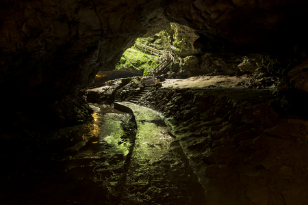 A Trail Leading Out Of A Cave Stock Photo