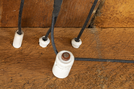 Old Outdated Electrical Wiring in the ceiling of an old house. Imagens