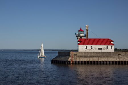 Lake Superior Breakwater Lighthouse with Sailboat
