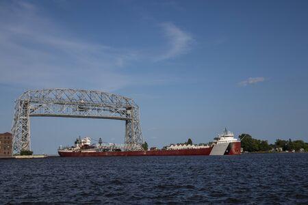 A Ship Passing Under A Lift Bridge