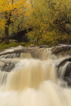 Miller Creek Waterfall and Footbridge In Autumn