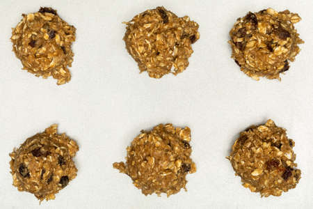 Oatmeal Raisin Cookie Dough Balls On Baking Sheet 写真素材