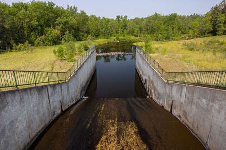 Hayes Lake Dam with a river below. Stock Photo