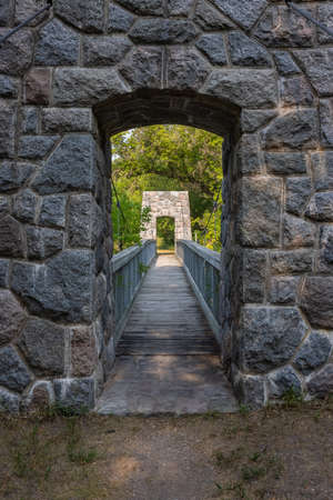 Swing Bridge On A Hiking Trail Stock Photo