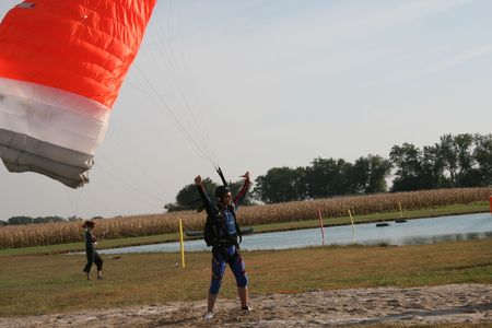 freefall: Skydiver in joy after landing in the best landing zone